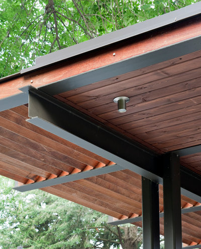 Patio details a modern pergola stands up to nebraska s for Steel and wood pergola