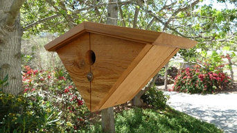 Eichler-inspired nest box with overhanging roof in natural cedar.