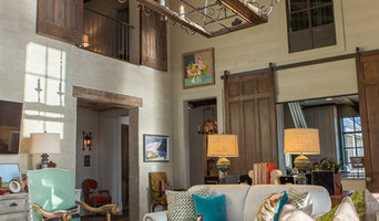 Family Room with custom made Chandelier, wood and brick walls and hand made door