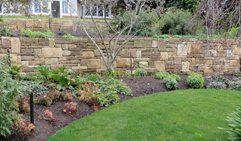 Feature walls and paths in large garden