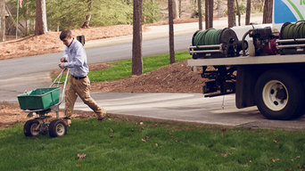 Spreading Fertilizer on Alpharetta, GA Lawn