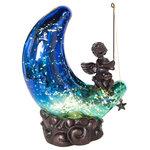 """River of Goods - 9.5"""" Moon and Cherub Accent Lamp, Teal/Blue - Celestial beauty accented with the rich color of glass.  Let the light from this 9.5""""H moon accent lamp bring a soft, comforting glow to your home.   A handblown glass shade in the shape of a crescent moon rests on a bed of clouds.  A metal cherub holds a fishing pole - hoping the catch a star from the night sky.  The detailed metalwork in both the clouds and the cherub bring dimension and shine.  This bright moon and cherub lamp is a perfect gift to show a loved one you are thinking of and caring about them"""