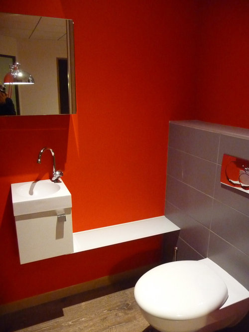 Powder Room Design Ideas, Remodels & Photos with Gray Tile and Red Walls