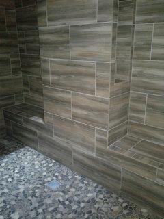 Can I put pebble tile on shower floor?