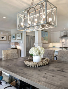 How far above a table should the bottom of a chandelier hang?