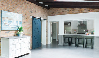 Old brick and beams paired great with the new custom Barn door