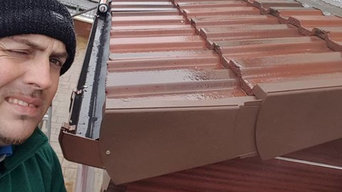 New Pitch Roof - All wood work uPVC facsia in brown new tiles