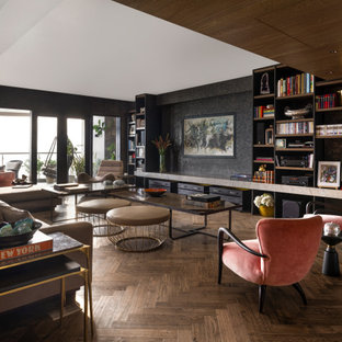 View of entire Living Room, showcasing pink 'Gio Ponti Armchairs'