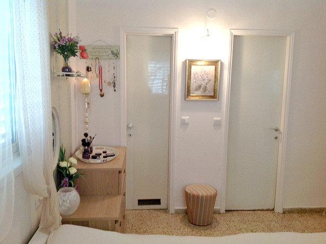 doors(closet+bathroom)+a light and painting in between.