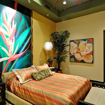 Inspiration for a mid-sized tropical home design remodel in Phoenix