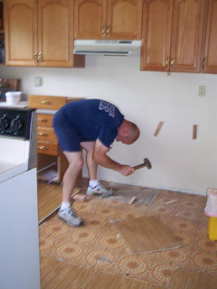 Removing kitchen tile floor without damaging or removing ...