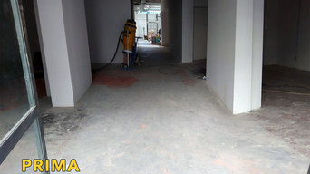 Levigatura cemento industriale, rimozione resina, consolidamento e colorazione