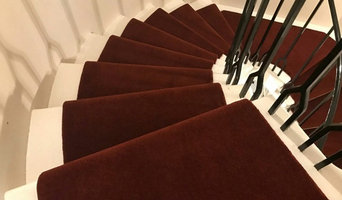 Red runner on a beautiful spiral staircase