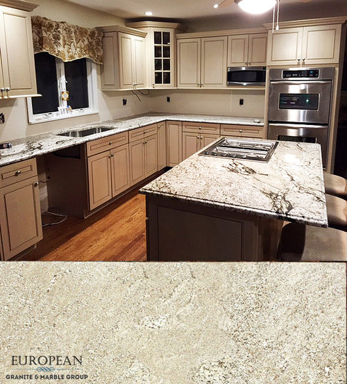 The Warm Tones In Granite Match Perfectly With Cream Off White Of Kitchen Cabinets