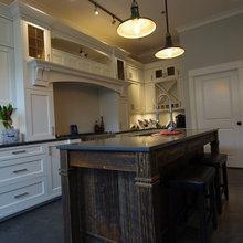 Rustic barnwood island and white Shaker cabinets