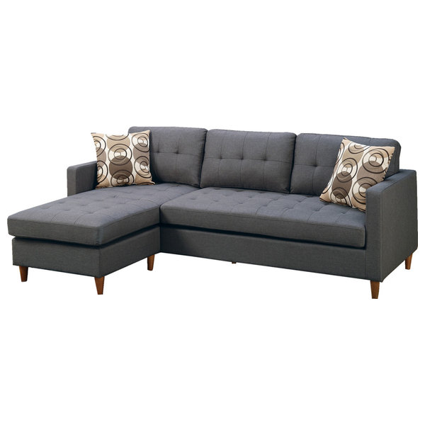 a grey sectional with two decorative pillows
