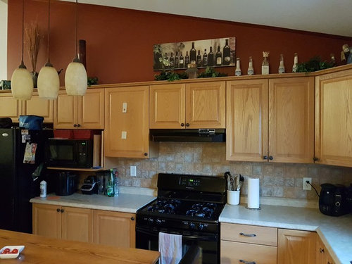 Light Or Dark Countertop With Oak Cabinets