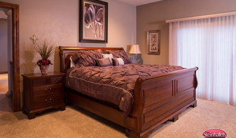 completed design photo of master bedroom, repainted, new bed covering, art and a