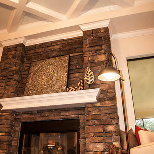 Inspiration for a large timeless open concept medium tone wood floor family room remodel in Tampa with a brick fireplace, beige walls and a standard fireplace