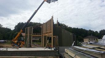 Construction d'une maison ossature bois avec bardage Pierre / Bois