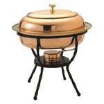 """Old Dutch International - Oval Decor Copper Over Stainless Steel Chafing Dish - For trend setting serve ware worthy of the finest table look no further than this elegant chafing dish. The hand-hammered bright copper finish and black iron stand elevate your gourmet fare to a new level. The 6 Qt. stainless steel food pan is held over a temperature-moderating water pan. The adjustable gel-fuel burner keep everything at the ideal temperature without drying out. Oven- and dishwasher safe stainless steel food pan. All other parts wipe clean. Adjustable fuel holder takes standard """"Sterno"""" type gel fuel canisters (not included). 6 Qt. capacity"""