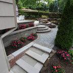 Bluestone Patio With Limestone Veneer Seat Wall