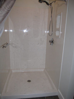 Cultured Marble Shower. Cultured Granite Vanity With Integral Sink In  Contrasting Color.
