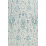 Company C - Caspar Rug, 7'6X9'6 Blue - A treasured design, our Caspar rug was influenced by beautiful all-natural wool yarns in grounding neutral colors. Artisans used a special weaving technique of hand-tufting with a loop pile, and over-tufting on the motif with ivory that both softens the design and lends a hand-drawn appearance to the rug. 100% wool, hand-tufted loop pile. Colors: Natural and Blue.