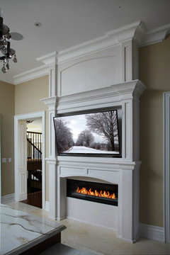 Can an above-fireplace wall-mounted T.V. be damaged by fireplace heat