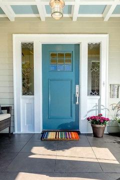 What about something in the coral orangy terracotta family for the front door color? OR a darker turquoise door........shade or 2 darker than your ceiling ... & Front entry concrete patio paint color
