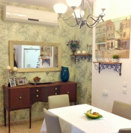 garden wallpaper and classic side board in the dining room