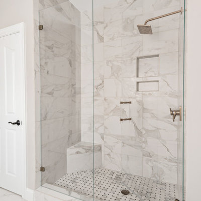 Mid-sized transitional master white tile and porcelain tile porcelain tile, white floor and double-sink bathroom photo in Charlotte with furniture-like cabinets, gray cabinets, gray walls, an undermount sink, quartz countertops, a hinged shower door, white countertops and a freestanding vanity