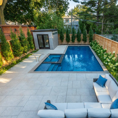 Pool landscaping - small transitional backyard stamped concrete and rectangular pool landscaping idea in Toronto