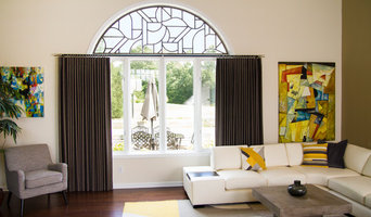 Tableaux grill for the arch window and functional panels for a Greenwood home