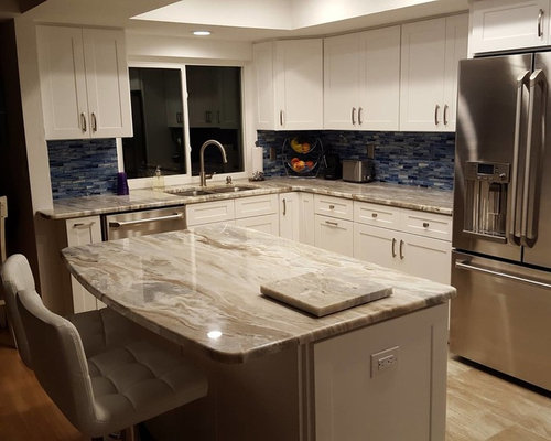 Fantasy Brown Granite with White Shaker Door Cabinets from Forevermark