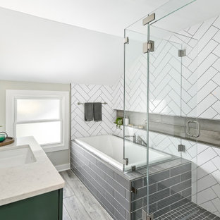 This is an example of a small contemporary master bathroom in Milwaukee with shaker cabinets, green cabinets, a drop-in tub, a corner shower, a two-piece toilet, white tile, porcelain tile, beige walls, vinyl floors, an undermount sink, engineered quartz benchtops, brown floor, a hinged shower door, white benchtops, a shower seat, a single vanity and a built-in vanity.