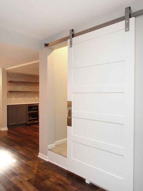Modern white wardrobe sliding door basement design ideas for Basement sliding doors