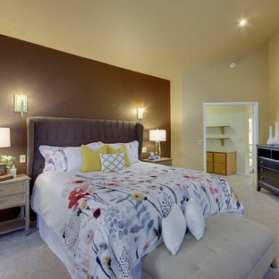 Inspiration for a mid-sized eclectic master carpeted and beige floor bedroom remodel in Austin with beige walls, a two-sided fireplace and a tile fireplace