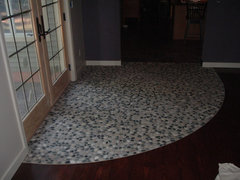 Curved Transition From Carpet To Tile