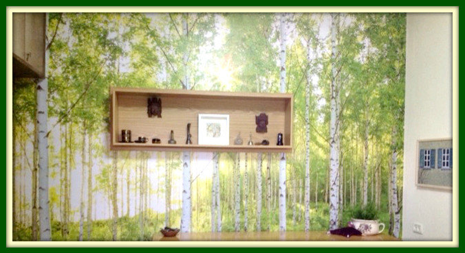 Bedroom main wall with nostalgic forest wallpaper and a custom made display box