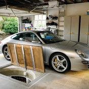 Reinforced Garage Trap Door with Opening Mechanism