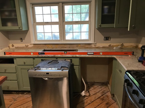 Granite countertop flawed installation level and seam on