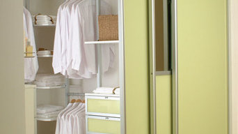 Yellow Primrose sliding doors on a walk in wardrobe with pole interior.