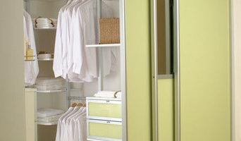 Yellow Primrose sliding doors on a walk in wardrobe with pole interior.