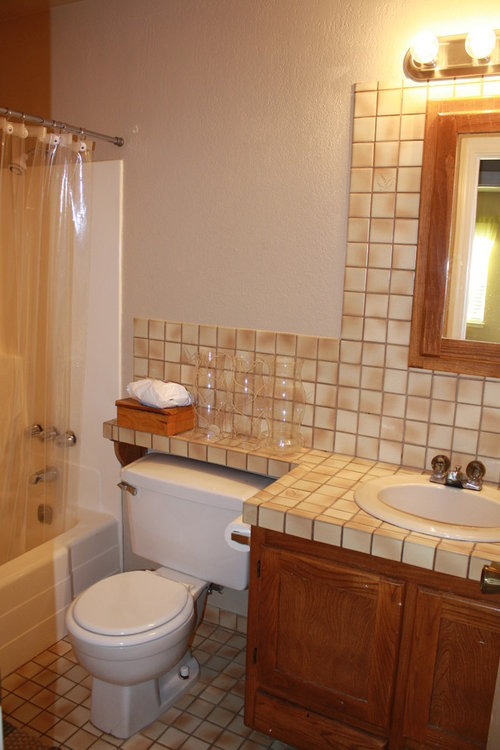 Removed Dated Tile Added A Chair Rail Duel Color Wall New Counter Top And Faucet Light Fixture Toilet Painted Cabinets