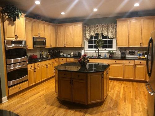 Dark Countertops And Golden Oak Floors