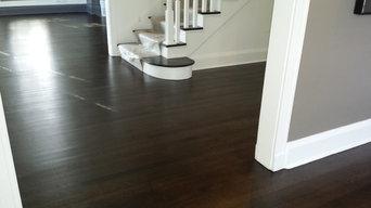 Refinishing hardwood floor with Ebony stain color using dustless system machine.