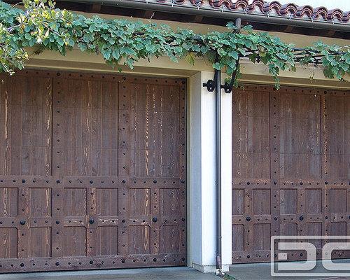 Spanish style garage doors custom designed handcrafted for Door in spanish