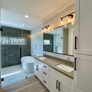 Mid-sized cottage master black tile and porcelain tile porcelain tile, brown floor and double-sink bathroom photo in Houston with shaker cabinets, white cabinets, gray walls, an undermount sink, quartz countertops, a hinged shower door, gray countertops and a built-in vanity