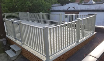 Roof top deck is pressure washed, sanded and covered with two coats of stain